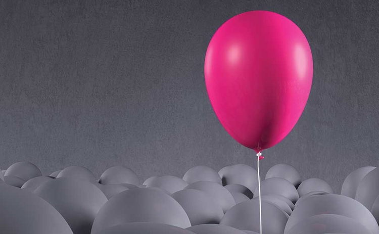 Pink balloon with grey balloons
