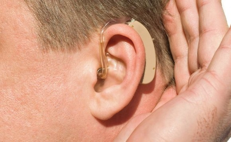 Man with a hearing aid