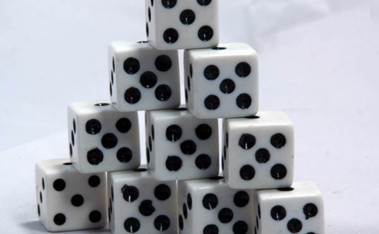 Ten dice displaying the number five