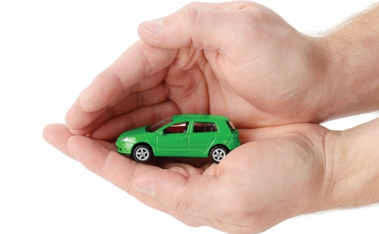 car-insurance-toy-car-hands-protect