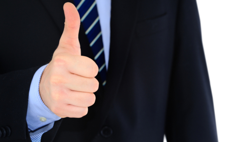 Positive thumbs-up businessman