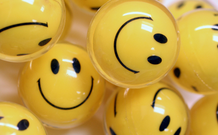 Concept image of yellow smiley face balls