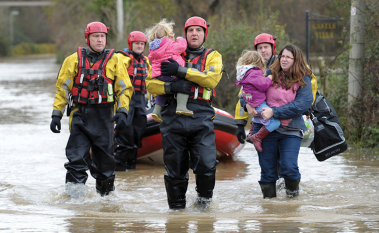 A family are rescued from their home in Gloucester during flooding on 27 November