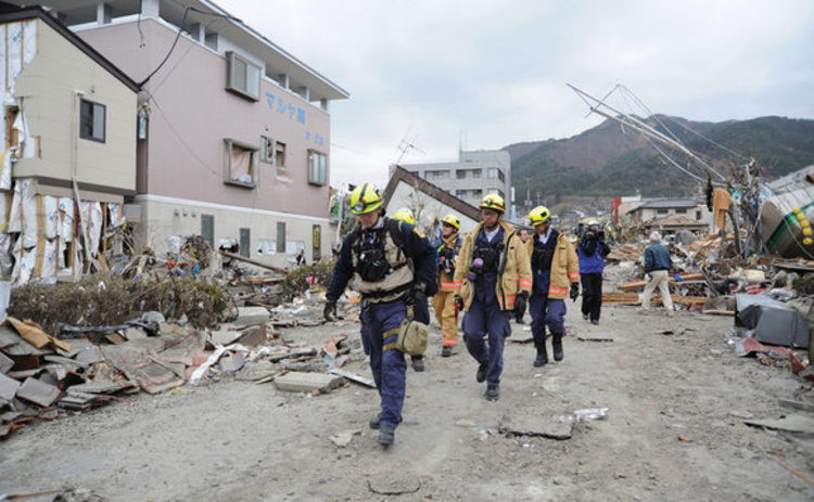 Members of Virginia Task Force 1 from the Fairfax County Fire and Rescue Department search for survivors in Ofunato Japan following an earthquake and subsequent tsunami