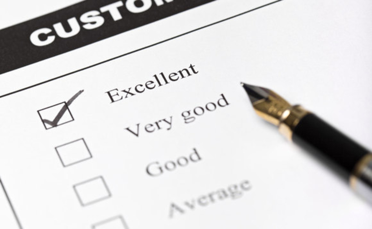 Customer satisfaction survey form with pen closeup with focus on the checked excellent checkbox