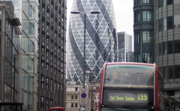 The financial centre of City of London with Swiss Re Building and London bus