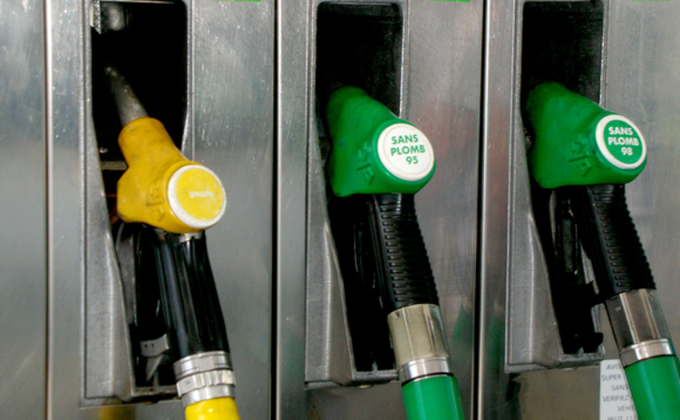 Petrol station yellow and green petrol pumps