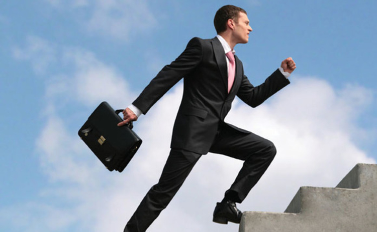 Businessman climbing staircase in the sky