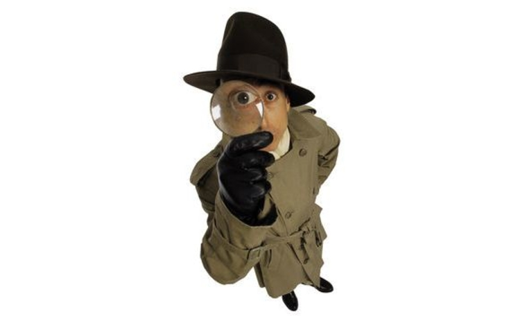A detective with a magnifying glass